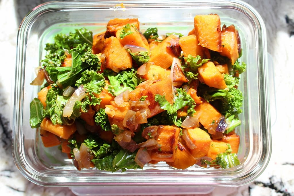 sweet potato, onion, and kale in tupperware