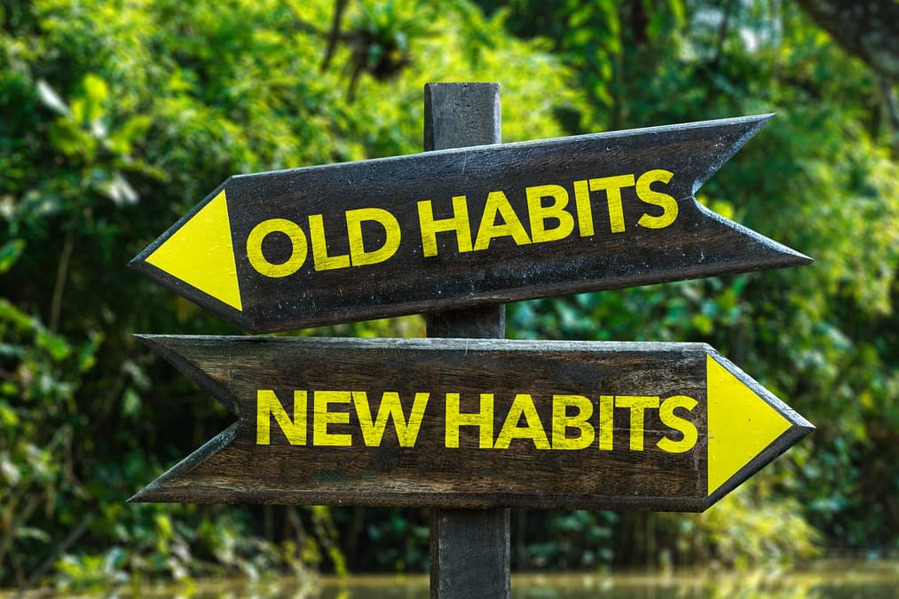 arrows pointing to old and new habits